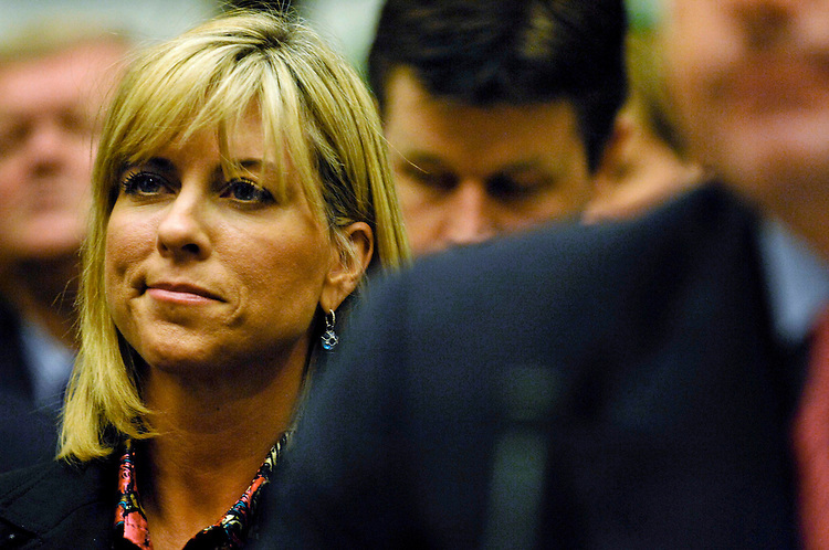 "WASHINGTON, DC - Feb. 13: Debbie Clemens, wife of former Major League pitcher Roger Clemens, right, reacts as her name is mentioned during opening statements during the House Oversight and Government Reform hearing on steroid use among MLB players. The two key figures in an escalating investigation of doping in Major League Baseball came to Capitol Hill Wednesday to tell opposing stories, publicly and under oath, about whether a former ace pitcher used steroids and human growth hormone during his baseball career. Roger Clemens and former trainer Brian McNamee offered diametrically opposing accounts the hearing that Chairman Henry A. Waxman, D-Calif., had wanted to cancel. Waxman said in his opening remarks that after weeks of lengthy depositions by ballplayers, evidence drudged up by committee investigators, and a flurry of sworn affidavits, his instinct ""was to cancel the hearing and release a report."" But the panel went forward with the hearing at the behest of Clemens' attorneys, the chairman said. (Photo by Scott J. Ferrell/Congressional Quarterly)"