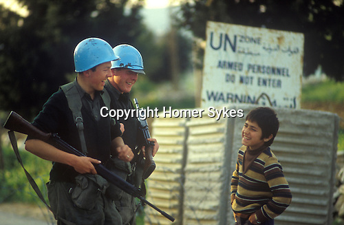 Irish UN, United Nations troops southern Lebanon 1980s. 46th Irish Battalion troops sharing a joke with a young Lebanese boy.  They were part of United Nations Interim Force in Lebanon UNIFIL