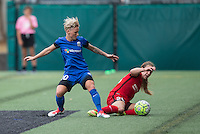 Seattle, WA - Saturday Aug. 27, 2016: Jessica Fishlock, Mallory Weber during a regular season National Women's Soccer League (NWSL) match between the Seattle Reign FC and the Portland Thorns FC at Memorial Stadium.