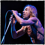 Iggy Pop and the reunited Stooges play as night falls on Coachella's main stage before headliners The Red Hot Chili Peppers take the stage