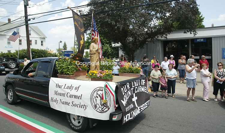WATERBURY CT 18  JULY, 2010-071810JW06- Our Lady of Mount Carmel Church truck carrying a statue of Jesus Christ drives down Highland Ave. Sunday afternoon as part of the 72nd church processional through the community.<br /> Jonathan Wilcox Republican-American
