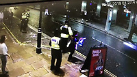 Pictured: A stolen car is driven at speed in Wind Street, a blocked off area in Swansea, Wales, UK.<br /> Re: Video footage has been posted online showing police trying to stop a stolen car which was being driven at speed down a blocked off road in the city centre of Swansea, Wales, UK.<br /> The incident happened during the early hours of Sunday, June 16.<br /> In the short video clip the car, believed to be a blue Ford Fiesta, can be seen moving at speed down Wind Street which is popular with revellers nd is full of bars and clubs, before doing a handbrake turn and speeding off while police try and chase it on foot.<br /> The car narrowly avoids striking the police officers and a man can be seen having to step sharply out of its path, with others running to safety.