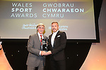 Wales Sport Awards 2013<br /> Cliff Jones receiving his award from Craig Bellamy<br /> 09.11.13<br /> ©Steve Pope-SPORTINGWALES