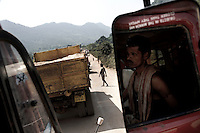 Trucks carrying bauxite and other materials are seen parked on the road leading to the Vedanta Alumina plant in Lanjigarh. The huge bauxite deposits in the Niyamgiri hills (seen in the distance) have led the Vedanta group to set up an alumina refinery at Lanjigarh, making the local population of Dongria Kondh tribespeople fearful for their future. Vedanta Resources has come under immense pressure from human rights and environmental groups to abandon its plans to mine at the Niyamgiri mountains, as the site is considered sacred by the local tribal community....