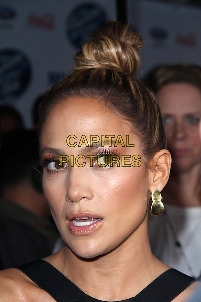 LOS ANGELES, CA - February 20: Jennifer Lopez at the American Idol XIII Finalists Party, Fig &amp; Olive, Los Angeles,  February 20, 2014. <br /> CAP/MPI/JO<br /> &copy;Janice Ogata/MediaPunch/Capital Pictures