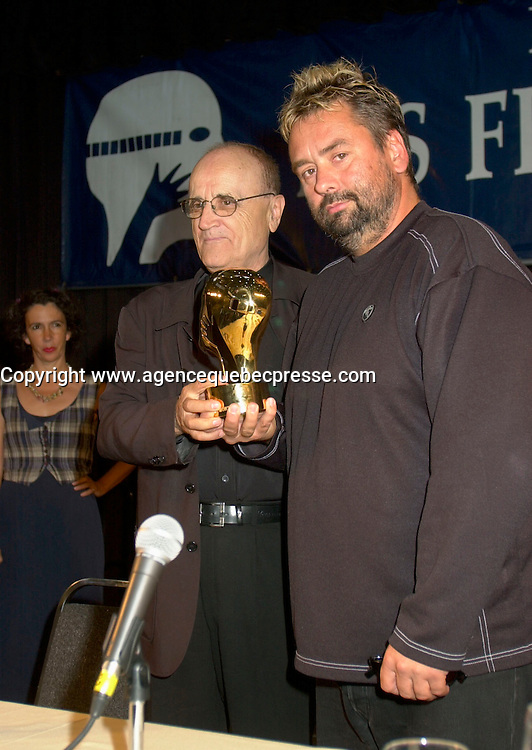 Aug 6 2002, Montreal, Quebec, Canada<br /> <br /> Serge Losique, Founder and President, World Film Festiva l(L)<br /> ,hands out a Grand Prize of The Americas Award to<br /> Luc Besson, French Film Maker and Producer(R), at a press conference, Aug 23,  2002, in  Montreal, Quebec, Canada<br /> <br /> Besson directed many films including Leon, Nikita (Original version), the 5th Element,...<br /> <br /> <br /> Mandatory Credit: Photo by Pierre Roussel- Images Distribution. (&copy;) Copyright 2002 by Pierre Roussel <br /> <br /> NOTE : <br />  Nikon D-1 jpeg opened with Qimage icc profile, saved in Adobe 1998 RGB<br /> .Uncompressed  Uncropped  Original  size  file availble on request.