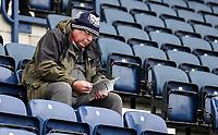 A fan reads a programme inside Deepdale, home of Preston North End<br /> <br /> Photographer Alex Dodd/CameraSport<br /> <br /> The EFL Sky Bet Championship - Preston North End v Blackburn Rovers - Saturday 26th October 2019 - Deepdale Stadium - Preston<br /> <br /> World Copyright © 2019 CameraSport. All rights reserved. 43 Linden Ave. Countesthorpe. Leicester. England. LE8 5PG - Tel: +44 (0) 116 277 4147 - admin@camerasport.com - www.camerasport.com