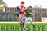 Mikey Ó Baoighill Daingean Uí Chúis beats Ciaran O'connor Mid Kerry to the loose ball during the County Minor championship final in Fitzgerald Stadium on Sunday