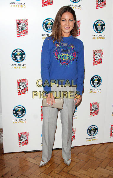 Louise Thompson<br /> The Guinness World Records 2014 Launch Party, One Marylebone, London, England.<br /> 17th September 2013<br /> full length grey gray trousers blue top kenzo clutch bag  <br /> CAP/ROS<br /> &copy;Steve Ross/Capital Pictures