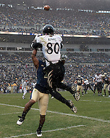 Cincinnati wide receiver Armon Binns (80) gets interfered with by Pitt defender Jovani Chappel. The Cincinnati Bearcats defeated the Pittsburgh Panthers 45-44 in the final seconds of the River City Rivalry in a contest for the Big East Championship and a major bowl bid on December 5, 2009 at Heinz Field, Pittsburgh, Pennsylvania. .