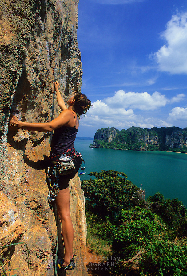 "Climber on ""Orange Juice"" 7b+ (Thaiwand Wall) Railay Beach, Thailand"