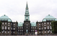 Copenhagen: Christianborg Palace--home of the three branches of government. This is the 3rd palace, finished in 1928. Neo-baroque design. Reinforced concrete & granite facing. Copper roofs since 1938. Weather vane with 2 crowns.