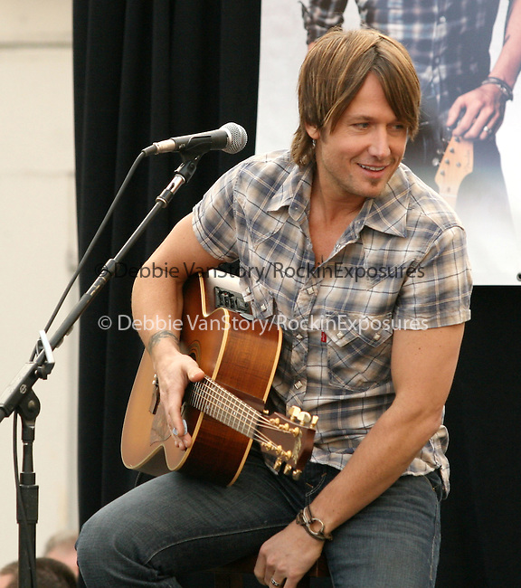 Keith Urban is joined by Verizon Wireless and Samsung Mobile as he makes an in-store appearance for his fans at the Verizon Wireless store in Pasadena, California on November 21,2009                                                                   Copyright 2009 Debbie VanStory / RockinExposures