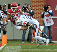NWA Democrat-Gazette/MICHAEL WOODS • @NWAMICHAELW<br /> University of Arkansas tight end Hunter Henry is tackled by Auburn defender Tray Matthews  after making a catching the 1st quarter of the Razorbacks 54-46 win over Auburn during Saturdays game at Razorback Stadium in Fayetteville.