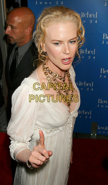 """NICOLE KIDMAN.""""Bewitched""""  World  Film Premiere, . Ziegfeld Theater, New York City, USA, .June 13, 2005..half length white cream floaty dress hand finger pointing gesture funny.Ref: IW.www.capitalpictures.com.sales@capitalpictures.com.©Ian Wilson/Capital Pictures."""