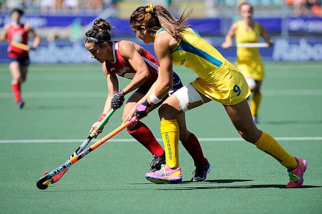 The Hague, Netherlands, June 12: Melissa Gonzalez #5 of USA controls the ball against Anna Flanagan #9 of Australia during the field hockey semi-final match (Women) between USA and Australia on June 12, 2014 during the World Cup 2014 at Kyocera Stadium in The Hague, Netherlands. Final score after full time 2-2 (0-1). Score after shoot-out 1-3. (Photo by Dirk Markgraf / www.265-images.com) *** Local caption ***
