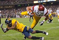 San Francisco, CA - October 13, 2011: USC fullback Rhett Ellison (40) and Cal defensive back Steve Williams (1). Cal Bears vs USC at AT&T Park in San Francisco, California. Final score Cal Bears 9, USC 30.