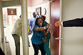 United States President Barack Obama greets hospital workers while visiting wounded service members at Walter Reed Army Medical Center in Washington, D.C., June 17, 2011. .Mandatory Credit: Pete Souza - White House via CNP