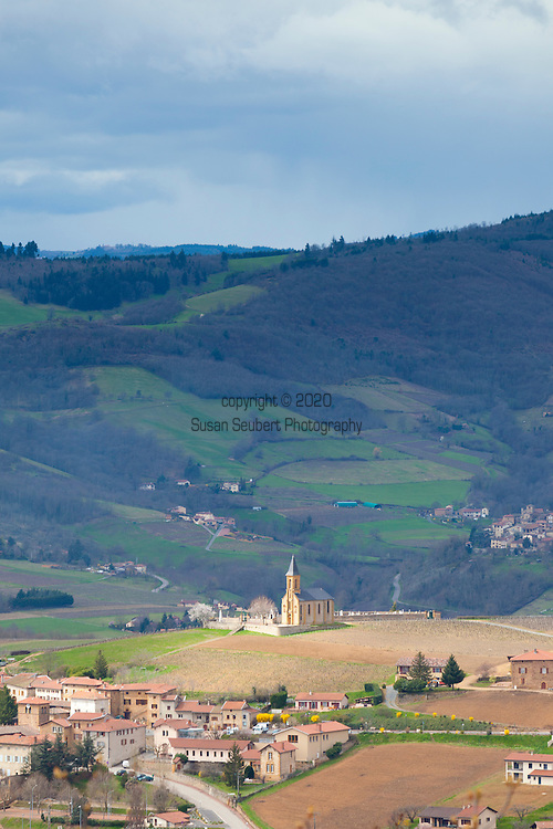 The Wine Route in early spring in Beaujolais, France. The hill town in southern Beaujolais of Midieval village of Oingt, famous for its yellow clay brick and views of surrounding villages.