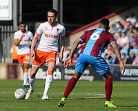 Blackpool's Antony Evans tries to find a way past Scunthorpe United's Funso Ojo<br /> <br /> Photographer David Shipman/CameraSport<br /> <br /> The EFL Sky Bet League One - Scunthorpe United v Blackpool - Friday 19th April 2019 - Glanford Park - Scunthorpe<br /> <br /> World Copyright © 2019 CameraSport. All rights reserved. 43 Linden Ave. Countesthorpe. Leicester. England. LE8 5PG - Tel: +44 (0) 116 277 4147 - admin@camerasport.com - www.camerasport.com