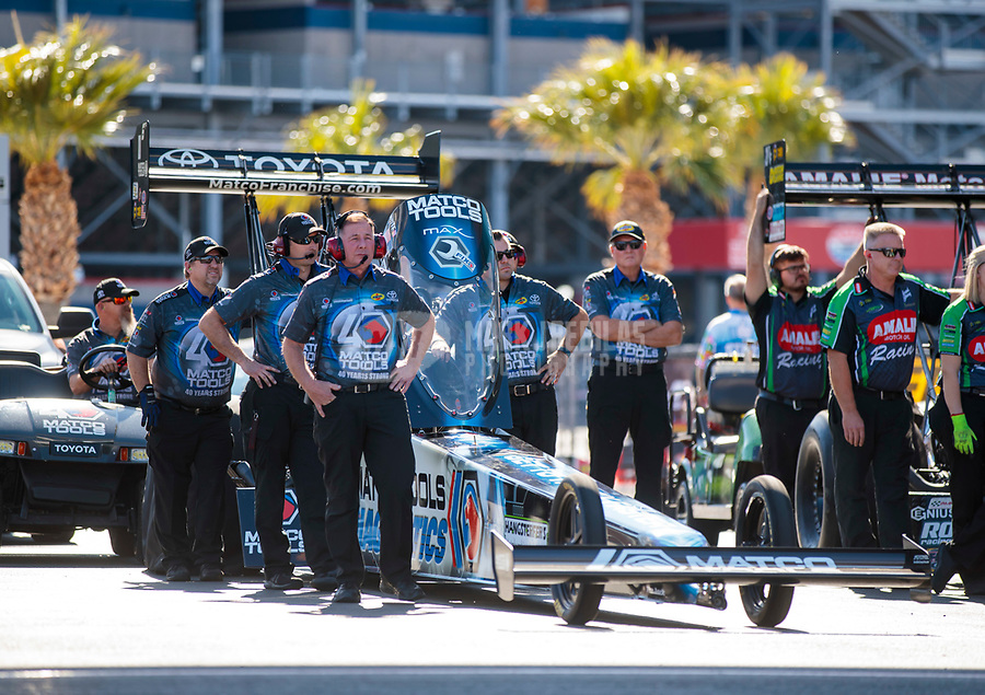 Nov 2, 2019; Las Vegas, NV, USA; Crew members for NHRA top fuel driver Antron Brown stand alongside his dragster during qualifying for the Dodge Nationals at The Strip at Las Vegas Motor Speedway. Mandatory Credit: Mark J. Rebilas-USA TODAY Sports