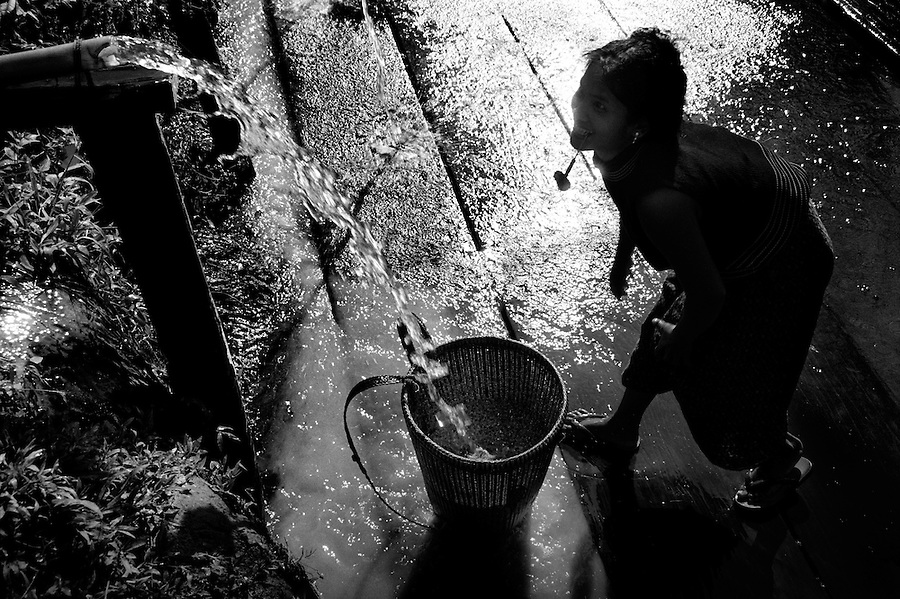 "Mekong Dam Victims - Cambodia. A woman cleaning rice. Her village has been relocated up in the hills far away from the original setting near the Se San river. At least 55.000 people living near the Sesan river in Cambodia's Ratanakiri and Stung Treng provinces continue to suffer due to lost rice production, lost fishing income, drowned livestock and damaged vegetable gardens, and so also great economical losses, because of the unpredictable floodings from the Yali Falls Dam on the other side of the border in Vietnam. To this day, flash floodings have caused the deaths of at least 39 villagers from various ethnic minority groups living along the river. Despite this, four other major hydropower projects are now in operation or under construction on the Sesan River in Vietnam. Known as ""The Mother of Waters"", more than 60 million people depend on the Mekong river and its tributaries for food, fresh water, transport and other aspects of daily life. The construction of big dams is now threatening the life of these people aswell as the vital and unique ecosystem of the river."