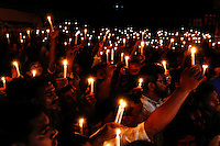 Bangladeshi relatives of victims of last year's Rana Plaza building collapse, along with activists hold candles during a gathering on the eve of the tragedy, the worst in the history of the garment industry, in Savar, near Dhaka, Bangladesh.