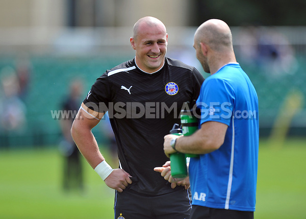 Carl Fearns has a chat with High Performance Manager Allan Ryan. Pre-season friendly match, between Bath Rugby and London Welsh on August 11, 2012 at the Recreation Ground in Bath, England. Photo by: Patrick Khachfe / Onside Images