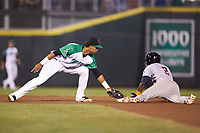 Vidal Brujan (2) of the Bowling Green Hot Rods slides safely into second base ahead of the tag by Dayton Dragons shortstop Jose Garcia (15) at Fifth Third Field on June 8, 2018 in Dayton, Ohio. The Hot Rods defeated the Dragons 11-4.  (Brian Westerholt/Four Seam Images)