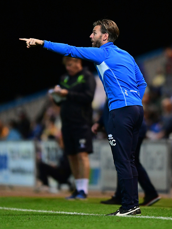 Lincoln City's assistant manager Nicky Cowley shouts instructions to his team from the technical area<br /> <br /> Photographer Chris Vaughan/CameraSport<br /> <br /> The EFL Checkatrade Trophy - Mansfield Town v Lincoln City - Tuesday 29th August 2017 - Field Mill - Mansfield<br />  <br /> World Copyright &copy; 2018 CameraSport. All rights reserved. 43 Linden Ave. Countesthorpe. Leicester. England. LE8 5PG - Tel: +44 (0) 116 277 4147 - admin@camerasport.com - www.camerasport.com