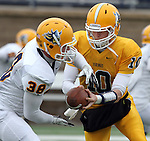 SIOUX FALLS, SD - MAY 4:  Justin Greenway #38 takes the hand off from Augustana quarterback Justin Heinrich #10 during the Vikings Spring Game Saturday morning at Kirkeby-Over Stadium on the Augustana College Campus. (Photo by Dave Eggen/Inertia)