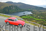 AUTUMN CLASSIC: Michael Liston from Tralee carefully negotiates a bend with his MG on the decent at the Kerry side of the Tim Healy pass overlooking Glenmore lake and Kilmakilloge harbour in last weekends Kingdom, Vintage, Veteran & Classic car club annual Autumn run based at the Kenmare Bay hotel.