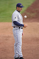 July 8, 2009: Tri-City Dust Devils pitching coach Darryl Scott flips a ball while he chats with his pitching staff prior to a Northwest League game against the Salem-Keizer Volcanoes at Volcanoes Stadium in Salem, Oregon.