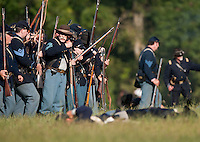 NWA Democrat-Gazette/BEN GOFF @NWABENGOFF<br /> Union soldiers advance on the Confederate States of America soldiers on Friday Sept. 25, 2015 during the Battle of Pea Ridge Civil War reenactment at Webb Farm near Pea Ridge. The event continues with battle reenactments at 2:00p.m. on Saturday and at 11:00a.m. Sunday.