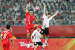 10 August 2008: Gao Lin (CHN) (9) and Thomas Vermaelen (BEL) (4) leap but miss a header.  The men's Olympic soccer team of Belgium defeated the men's Olympic soccer team of China 2-0 at Shenyang Olympic Sports Center Wulihe Stadium in Shenyang, China in a Group C round-robin match in the Men's Olympic Football competition.
