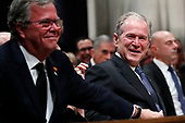 Former President George W. Bush smiles with his brother Jeb Bush at the State Funeral for their father, former President George H.W. Bush, at the National Cathedral, Wednesday, Dec. 5, 2018, in Washington. <br /> Credit: Alex Brandon / Pool via CNP