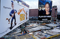 A shanty town community living under movie billboards on Insurgentes Norte, Mexico City.