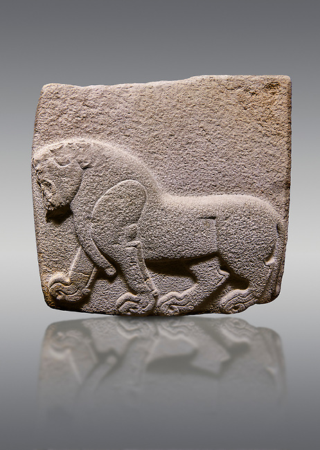 Aslantepe Hittite relief sculpted orthostat stone panel. Limestone, Aslantepe, Malatya, 1200-700 B.C. . Anatolian Civilisations Museum, Ankara, Turkey. Depiction of a horse walking.<br /> <br /> Against a gray background.