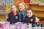 Kayleigh Enright and Breanna Moynihan with Teacher Mary Dillane pictured on their first day of school at Listellick  national school, Tralee on Friday.
