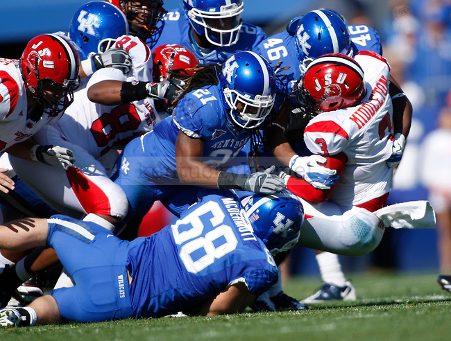 Jacksonville State running back Calvin Middleton gets tackled by a slew of Kentucky defenders during the first half of UK's home game against Jacksonville State in Commonwealth Stadium in Lexington, Ky. Oct. 22, 2011. Photo by Brandon Goodwin | Staff