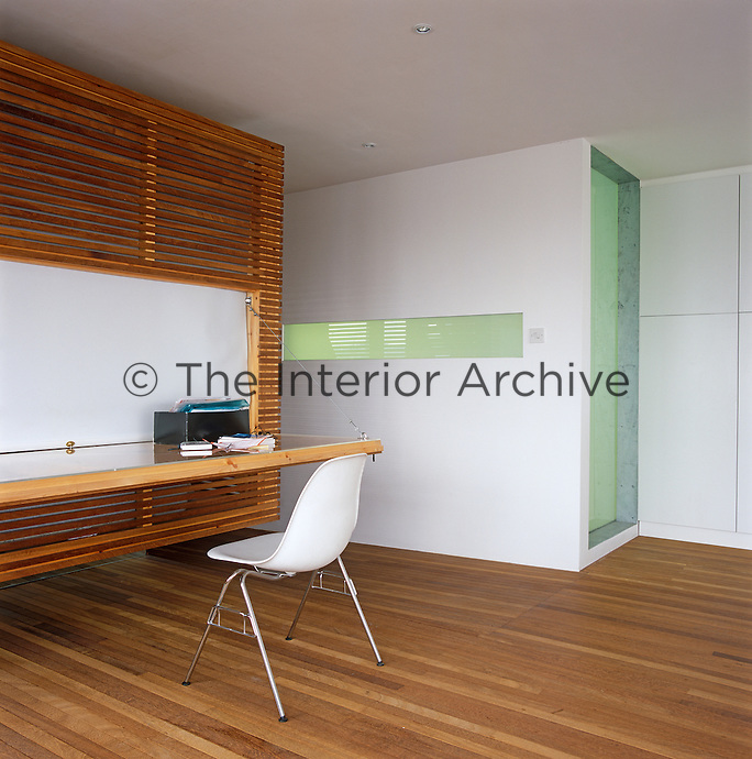 The enclosed sleeping area made of iroko, an African hardwood, has a panel that drops down to provide a desk area