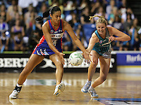 """20.03.2010 Mystics Maria Tutaia and Thunderbirds Georgia Beaton in action during the ANZ Champs Netball match between the Mystics and Thunderbirds at Trusts Stadium in Auckland. Mandatory Photo Credit ©MBPHOTO. """"FREE FOR EDITORIAL USE"""""""