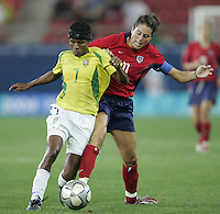 26 August 2004: Julie Foudy battles for the ball against Formiga of Brazil during the Gold Medal game at Karaiskakis Stadium in Athens, Greece.  USA defeated Brazil, 2-1 in overtime!.