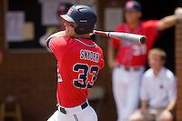Matt Snyder #33 of the Ole Miss Rebels follows through on his swing against the St. John's Red Storm at the Charlottesville Regional of the 2010 College World Series at Davenport Field on June 6, 2010, in Charlottesville, Virginia.  The Red Storm defeated the Rebels 20-16.  Photo by Brian Westerholt / Four Seam Images