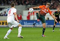 FUSSBALL  1. BUNDESLIGA  SAISON 2011/2012  31. SPIELTAG 13.04.2012 VfB Stuttgart - SV Werder Bremen Niclas Fuellkrug (re, SV Werder Bremen) gegen Georg Niedermeier (VfB Stuttgart)