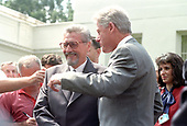United States President Bill Clinton and President Emil Constantinescu of Romania meet reporters after their meeting at the White House in Washington, DC on Thursday, July 16, 1998.<br /> Credit: Ron Sachs / CNP