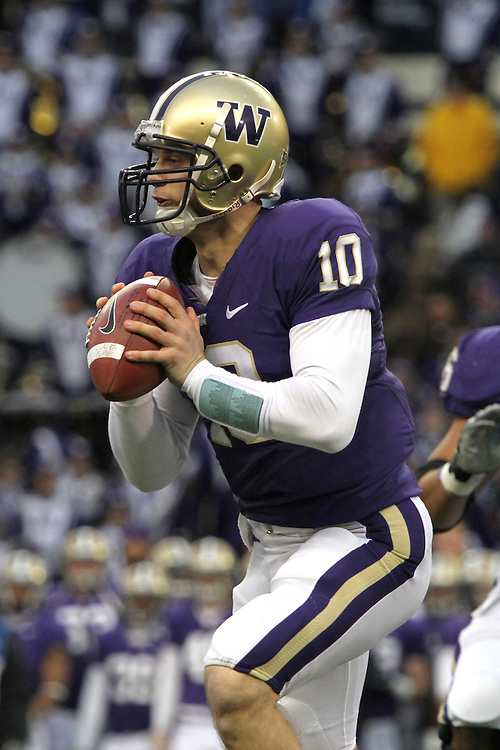 Jake Locker, University of Washington quarterback, looks down field for an open receiver during the Huskies annual Apple Cup rivalry game against Washington State on November 28, 2009.  Locker and the Huskies prevailed in the contest at Husky Stadium, 30-0.
