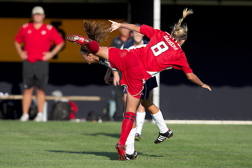 Wisconsin midfielder Leigh Williams (#8) and Notre Dame midfielder Mandy Laddish (#2) in action during NCAA Women's soccer match between Wisconsin and Notre Dame.  The Notre Dame Fighting Irish defeated the Wisconsin Badgers 2-0 in match at Alumni Field in South Bend, Indiana.