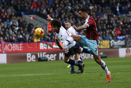 27.02.2016. Macron Stadium, Bolton, England. Skybet Championship. Bolton versus Burnley.Andre Gray of Burnley  sees his shot saved as Derik Osede of Bolton Wanderers attempts to block the shot