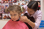 Berkeley CA Girl, three-years-old getting her first haircut at children's salon
